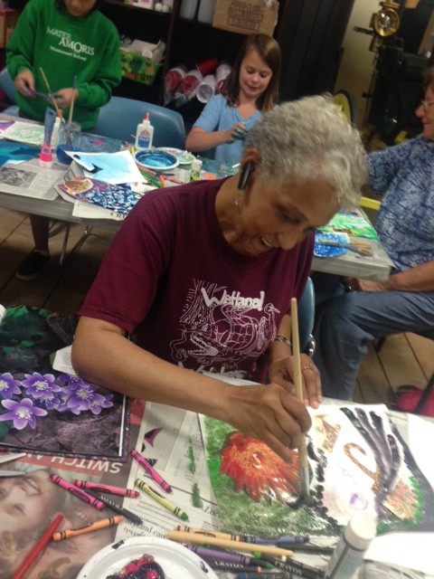 Joyce Sampson working on her art journal